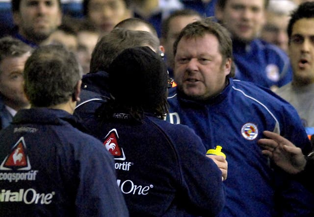 Wally Downes (right) , during his spell as Reading's first team coach, confronts Sheffield United manager Neil Warnock (centre) on the touchline.