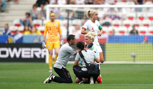 Millie Bright receives treatment against Scotland