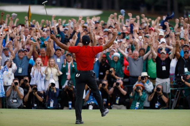 Tiger Woods salutes the crowd after winning the Masters