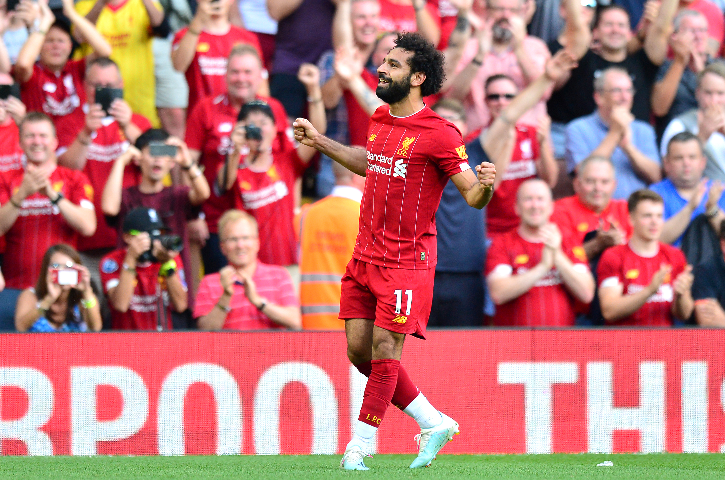 Salah nets a brace as Liverpool down Elneny's Arsenal 3-1