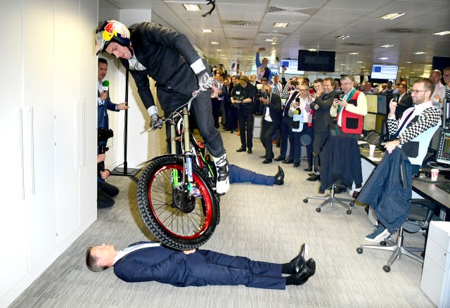 A stunt cyclist performs