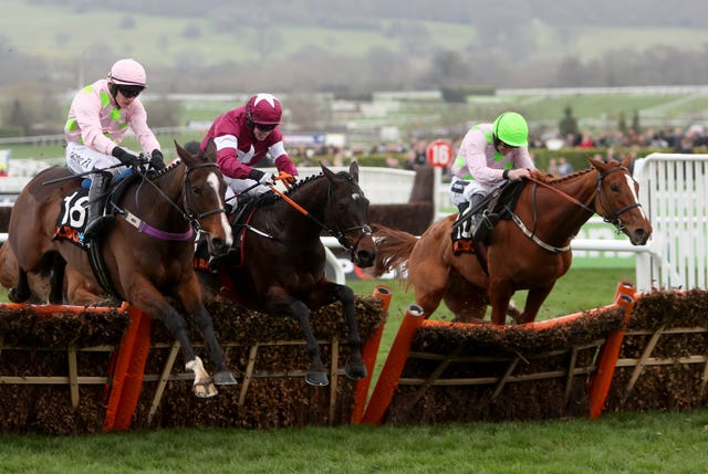 Limini (right) jumps the final flight before finishing third in the 2017 Mares' Hurdle