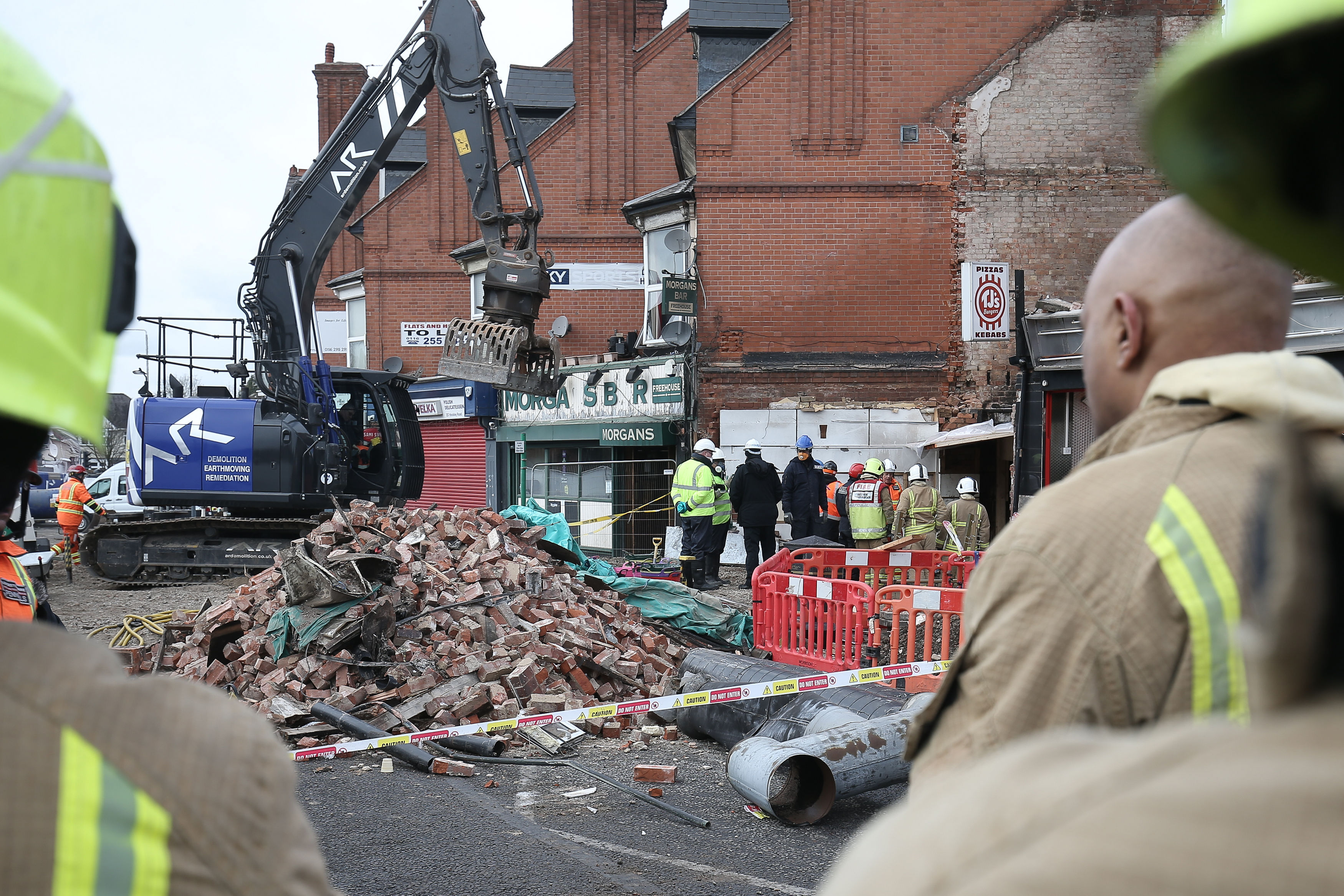 Emergency services at the scene on Hinckley Road in Leicester where police have named five victims of the explosion