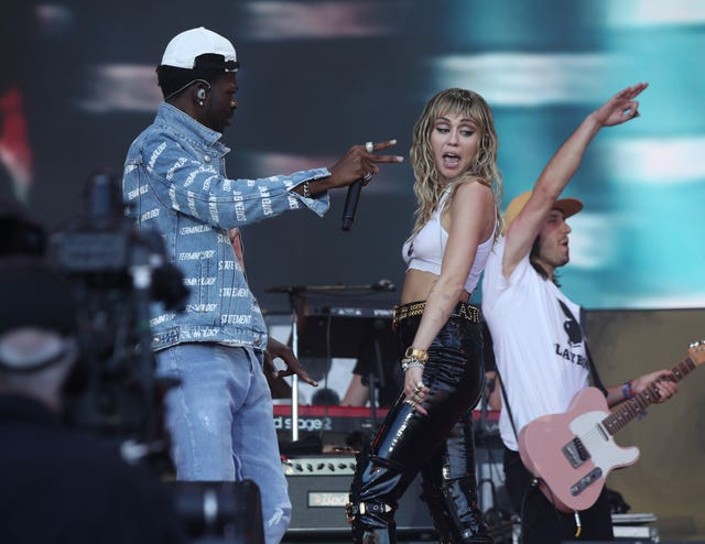 Miley Cyrus performing on the Pyramid Stage