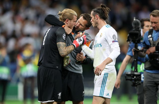 Loris Karius is consoled by Liverpool goalkeeping coach John Achterberg, centre, and Gareth Bale