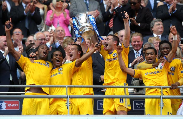 Frank Lampard, third right, lifts the trophy in 2009 after firing Chelsea's winner against Everton