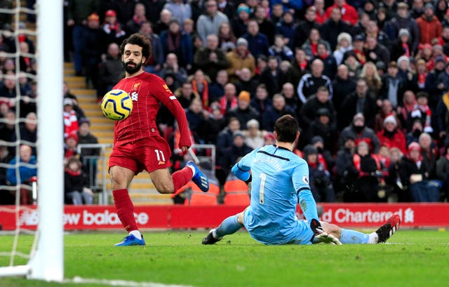 Liverpool's Mohamed Salah (left) scores a brace in the 4-0 win over Southampton