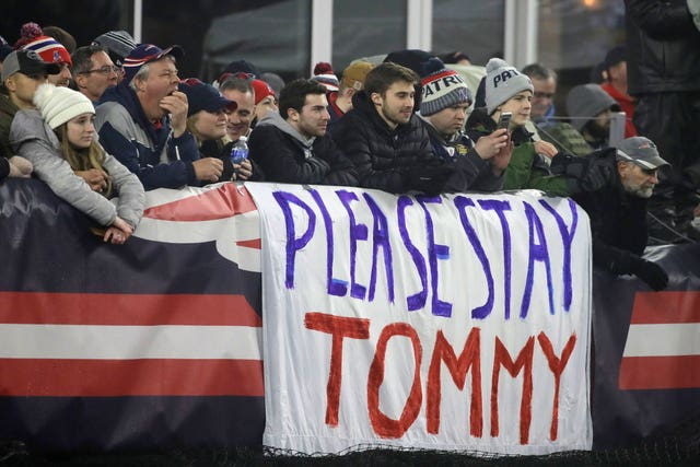 New England Patriots fans display a banner reading