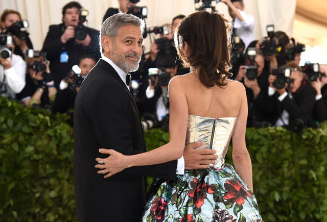 George Clooney with his wife (Evan Agostini/Invision/AP)