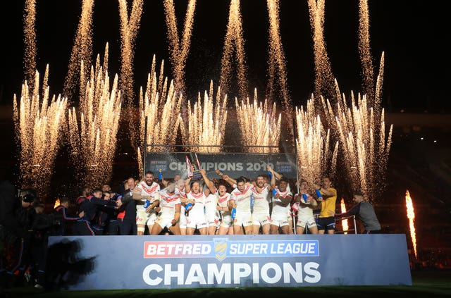 St Helens lift the Super League trophy after beating Salford in the Grand Final at Old Trafford