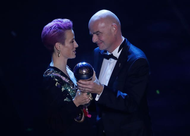 Megan Rapinoe receives the Best FIFA Women's player award from FIFA president Gianni Infantino