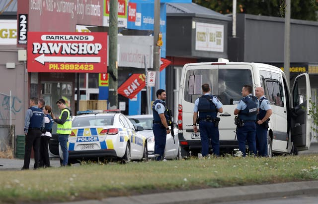 Police stand outside a mosque in Linwood, Christchurch