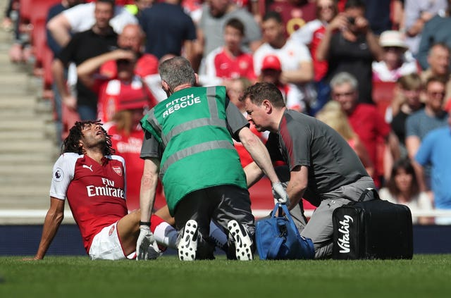 Mohamed Elneny suffered the injury at the end of the first half of Sunday's win over West Ham