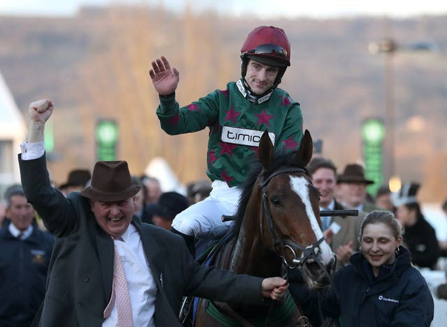 Brian Hughes celebrates on Mister Whitaker after victory at Cheltenham
