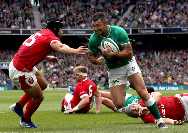 Rob Kearney goes past Wales' Leigh Halfpenny to score Ireland's fourth try in the 19-10 victory