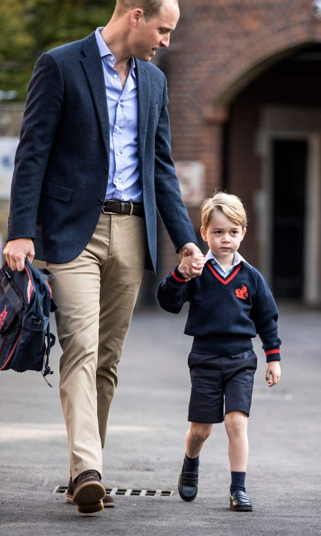 Prince George and his father the Duke of Cambridge on his first day at school at Thomas's Battersea (Richard Pohle/The Times/PA)