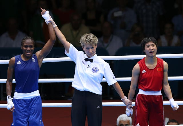 Adams beat Ren Cancan to win the irst women's Olympic gold in London