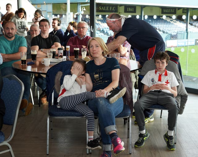 England fans watch the match at Sale Rugby Club