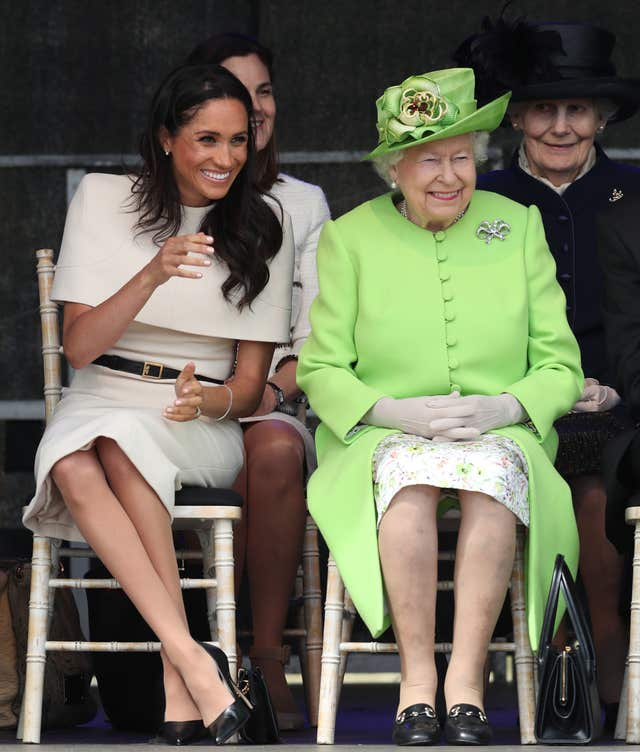 Meghan with the Queen