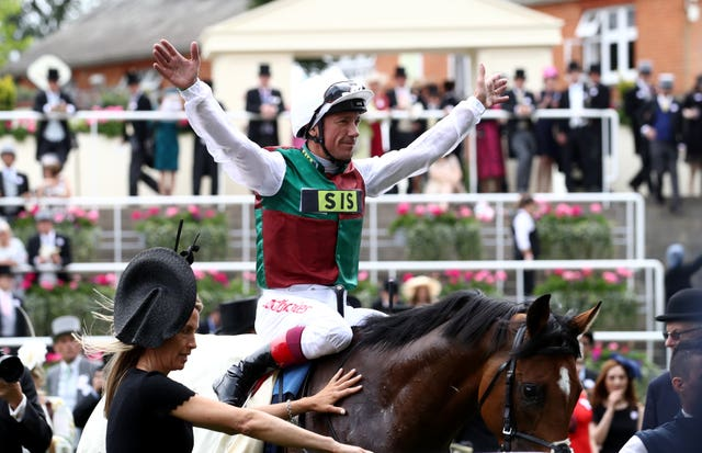Frankie Dettori celebrates after the win of Without Parole