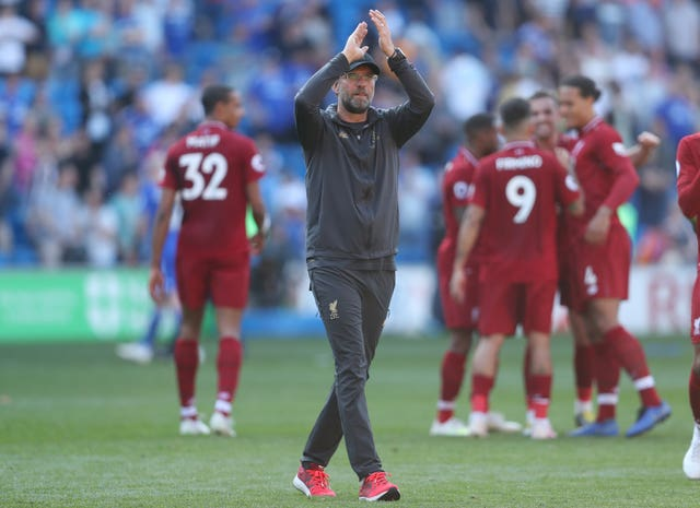 Liverpool manager Jurgen Klopp, centre, acknowledges the fans after a vital win at Cardiff