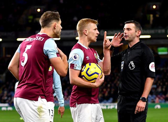 Match referee Michael Oliver waits for the VAR decision after Chelsea's Callum Hudson-Odoi goes down in the penalty area in Burnley