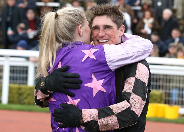 Honours equal? This year's County Hurdle hero Harry Skelton celebrates with partner and last year's winner Bridget Andrews
