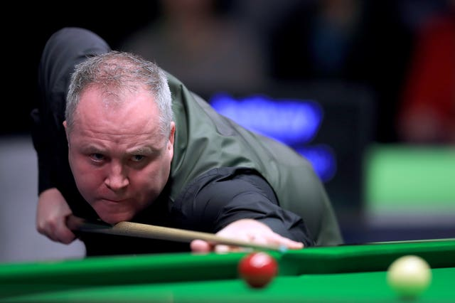 John Higgins has hinted at retirement