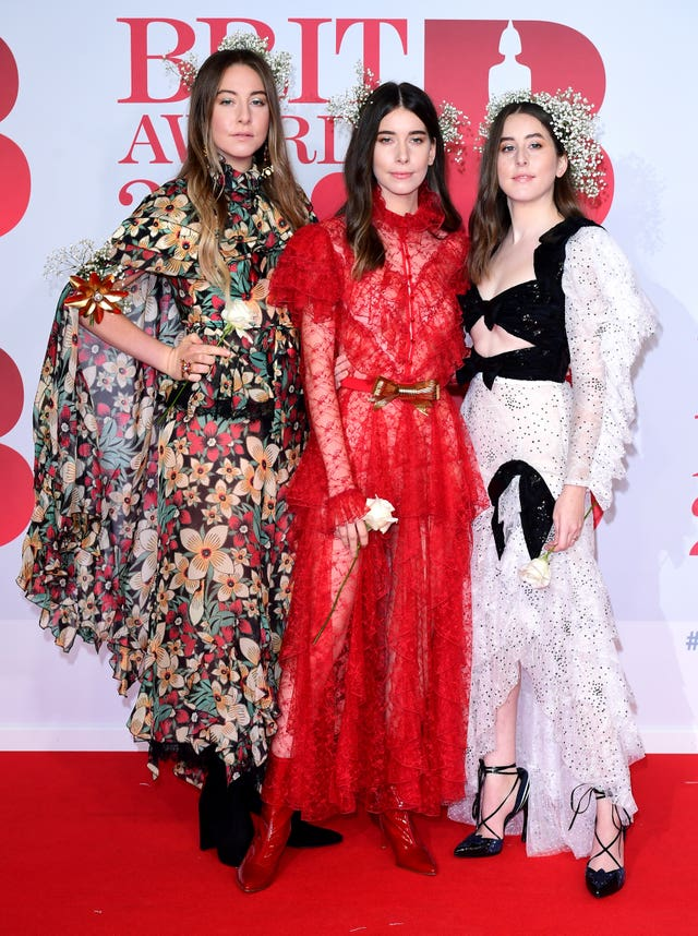Haim's Este, Danielle and Alana take to the red carpet (Ian West/PA)
