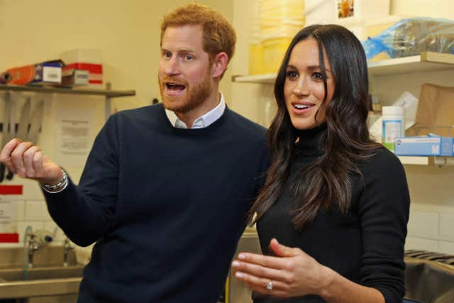 Prince Harry and Meghan Markle during a visit to Social Bite (Owen Humphreys/PA)