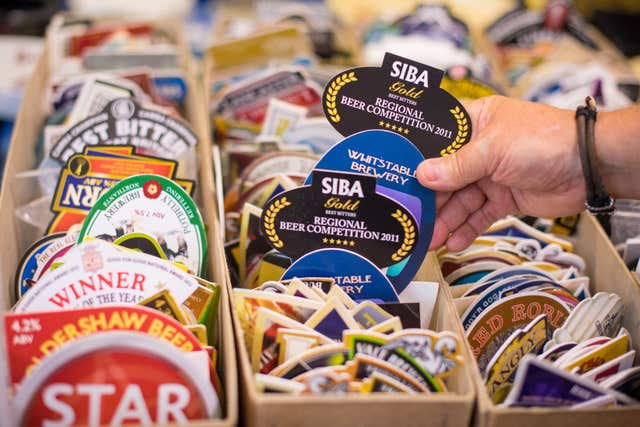 A visitor browses beer mats on sale