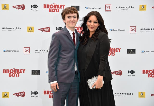 Brenock O'Connor and Martine McCutcheon attending The Bromley Boys World Premiere held at Wembley Stadium in London (Matt Crossick/PA)