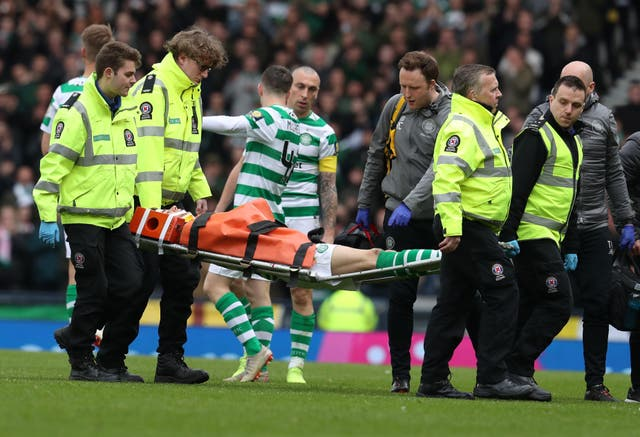 Ryan Christie leaves the field on a stretcher