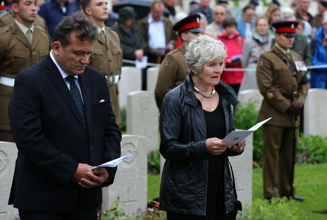 Margot Bains, niece of Private Henry Wallington, one of two young privates and an unknown soldier, who fought during the First World War, reads a poem during a burial service at Hermies Hill British Cemetery, near Albert, France