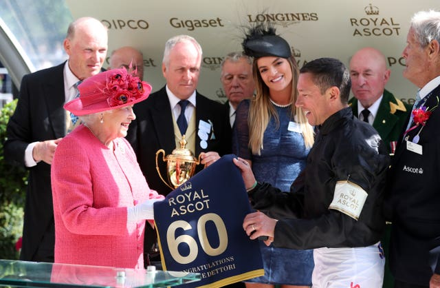 The Queen presented Dettori with a special memento for his 60th Royal Ascot win after last year's Gold Cup
