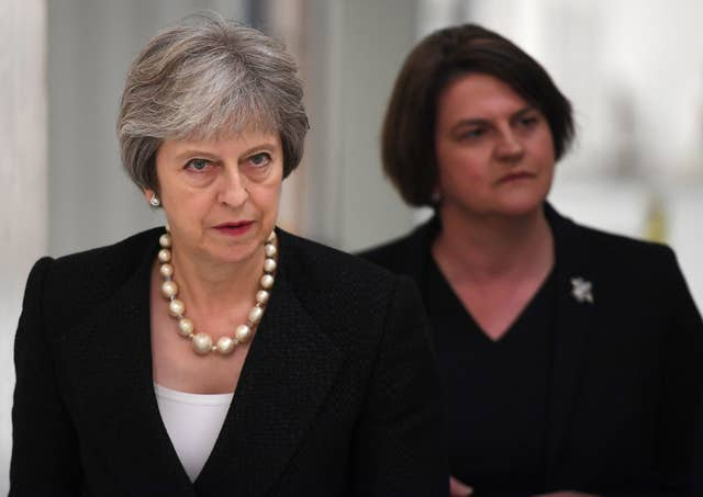 Theresa May depends on the 10 MPs from Arlene Foster's DUP to support her minority administration (Clodagh Kilcoyne/PA)