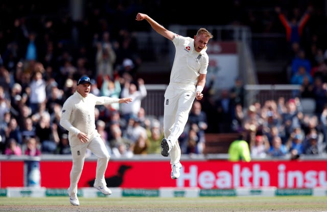 Stuart Broad celebrates taking the wicket of David Warner on Saturday
