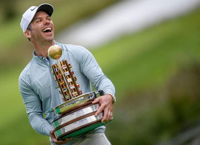 England's Paul Casey celebrates with the trophy after winning the European Open golf tournament in Hamburg
