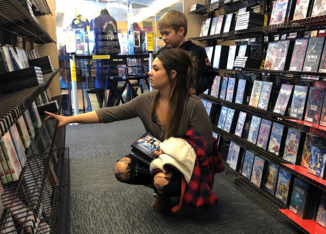 Tia Thiel and her son, Micah Knox, 7, browse a selection of movies