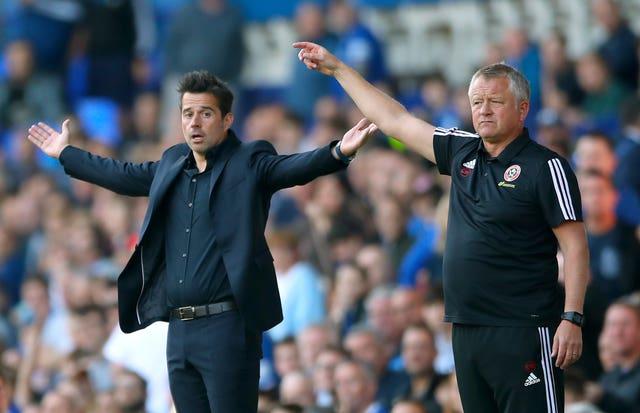 Marco Silva,left, came off second best against Sheffield United boss Chris Wilder