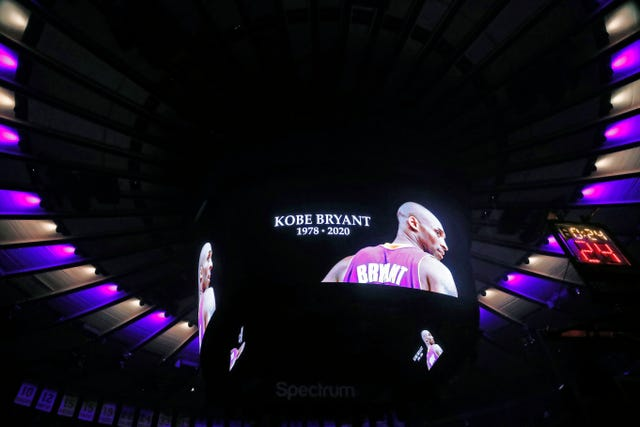 The ceiling of Madison Square Garden is lit in the colours of the Los Angeles Lakers as Kobe Bryant's picture is displayed on a video screen