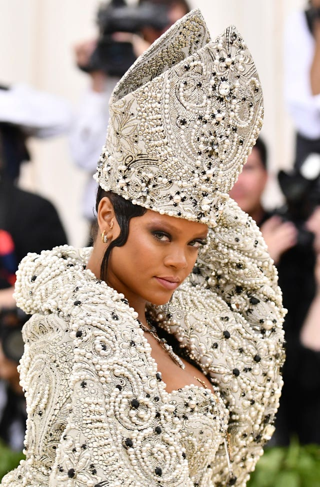 Rihanna's mitre-style hat followed the religious theme of Heavenly Bodies: Fashion and the Catholic Imagination (Charles Sykes/AP)