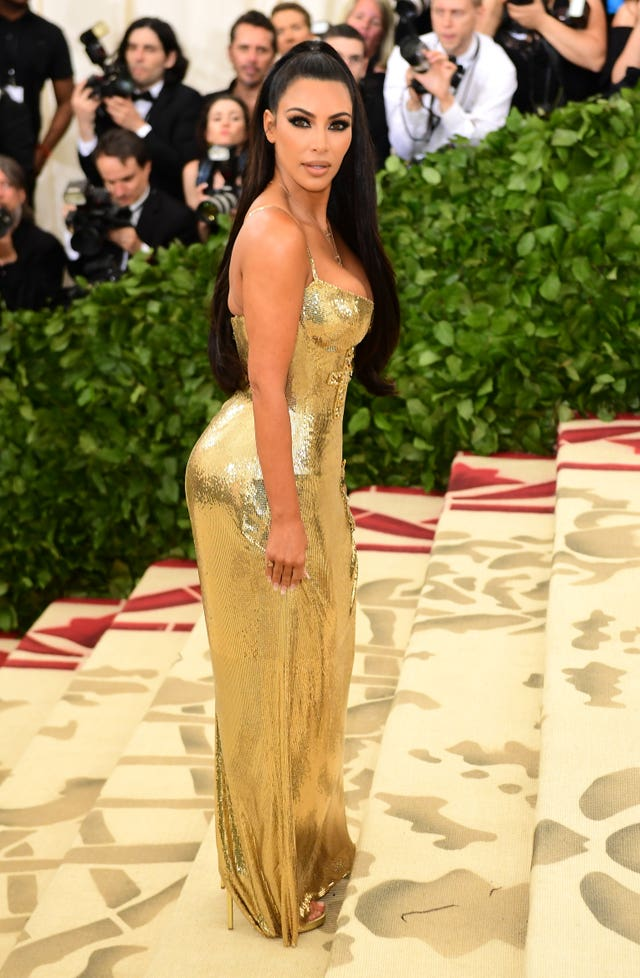 Kim Kardashian-West in a Versace dress (Ian West/PA)