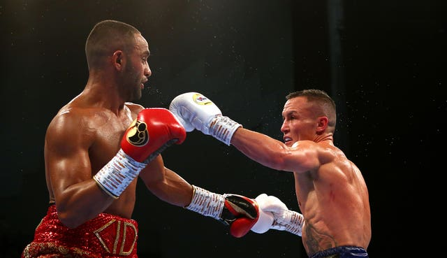 Josh Warrington beat Kid Galahad to retain his IBF world featherweight title in Leeds