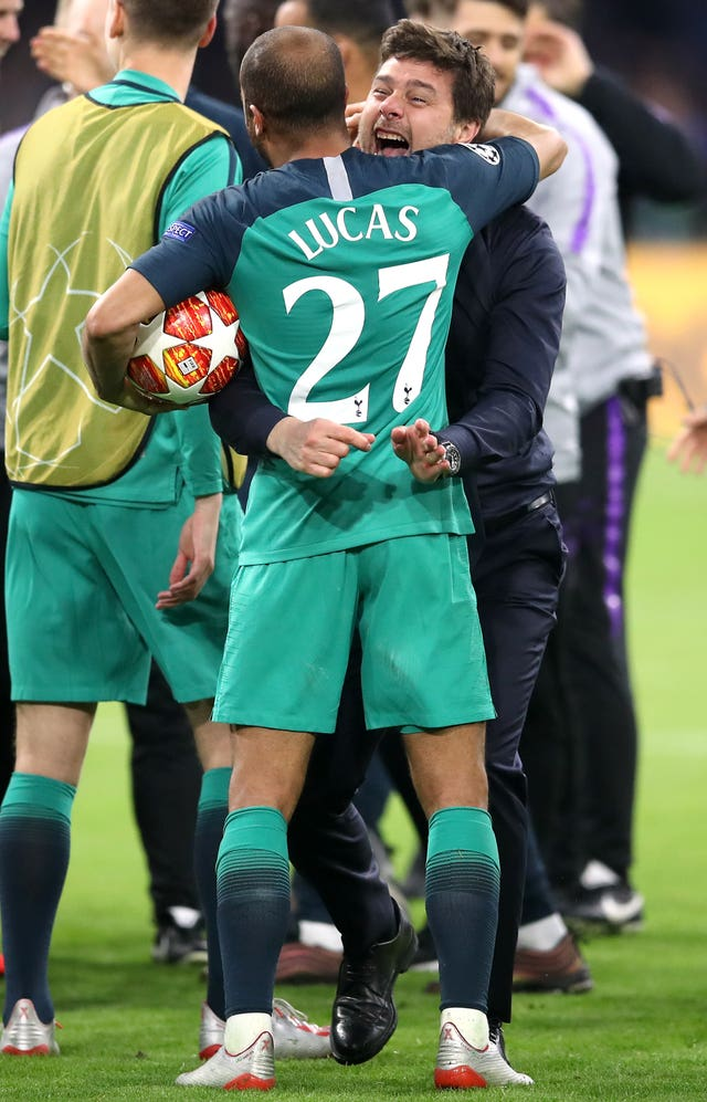 Lucas Moura (left) and manager Mauricio Pochettino celebrate after the final whistle of the Champions League semi-final in Amsterdam.