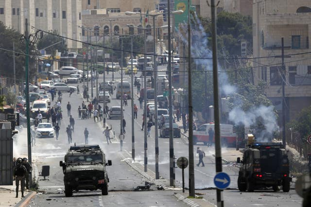 Palestinians clash with Israeli troops in Bethlehem (Majdi Mohammed/AP)