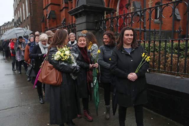 People queue to pay their respects to Cranberries singer Dolores O'Riordan (Niall Carson/PA)