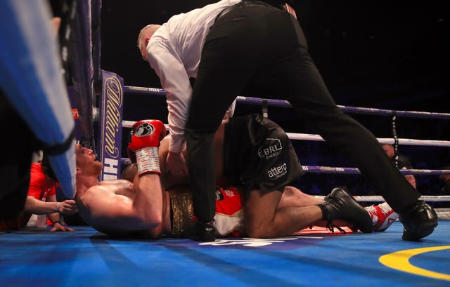 The referee intervenes as David Price (left) is bitten on the torso by Kash Ali during their heavyweight bout