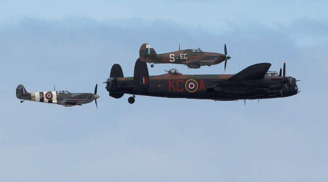 A Lancaster bomber, a Spitfire and a Hurricane in a Battle of Britain memorial flight (Peter Byrne/PA)