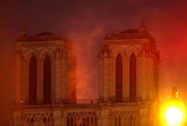 Notre Dame's famous towers engulfed in smoke (